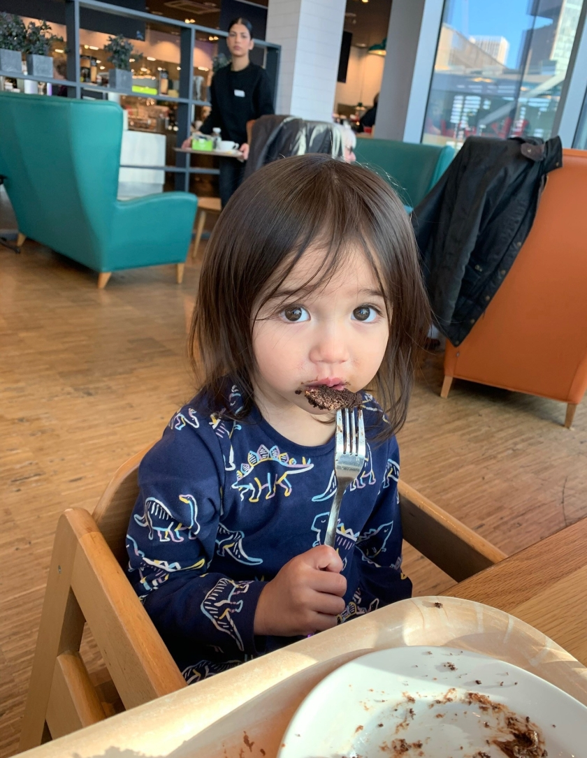 Ada and chocolate cake at Marks & Spencer